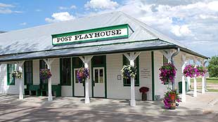 the front of the playhouse in the day